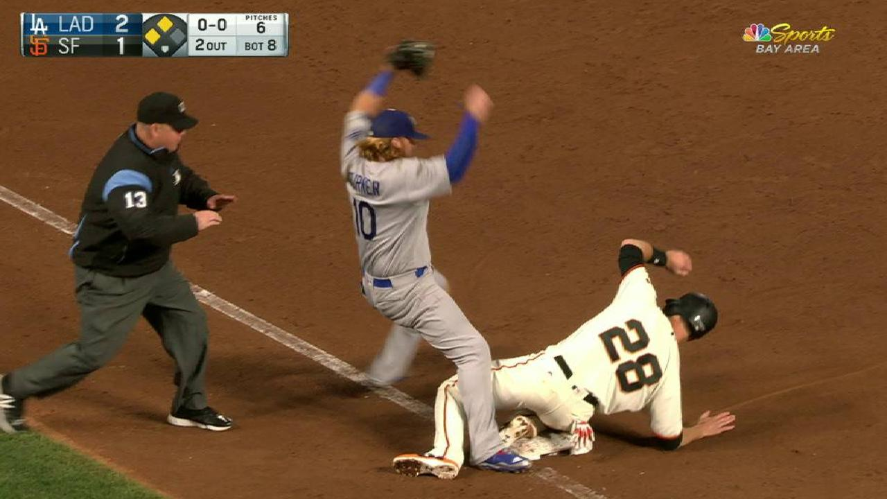 Posey slides safely into third