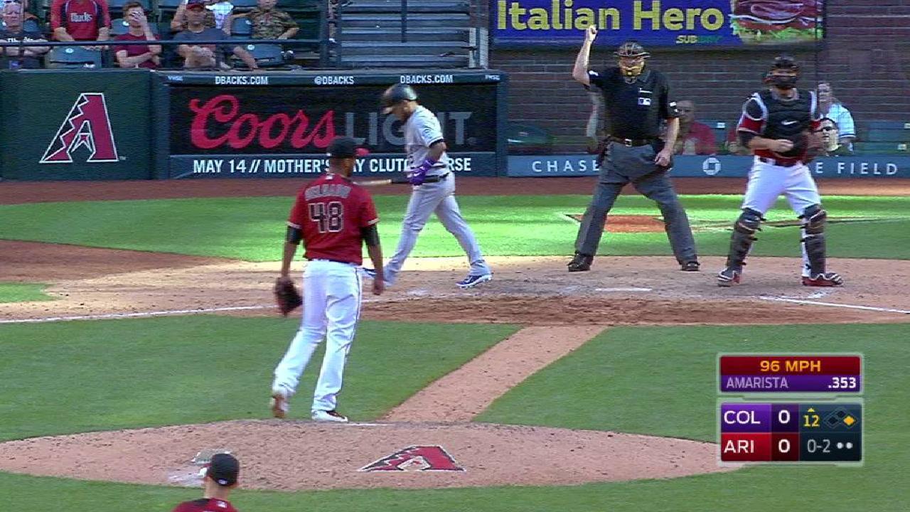 Delgado strikes out the side