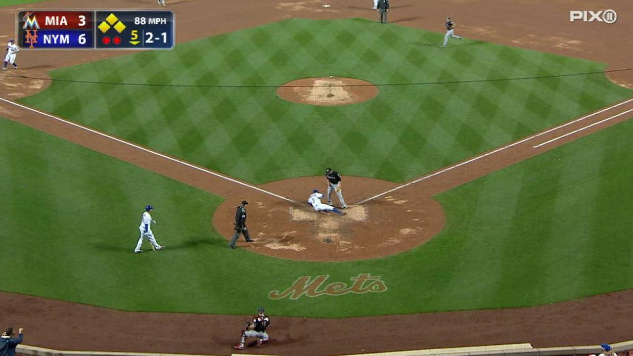 Grandy comes home on passed ball