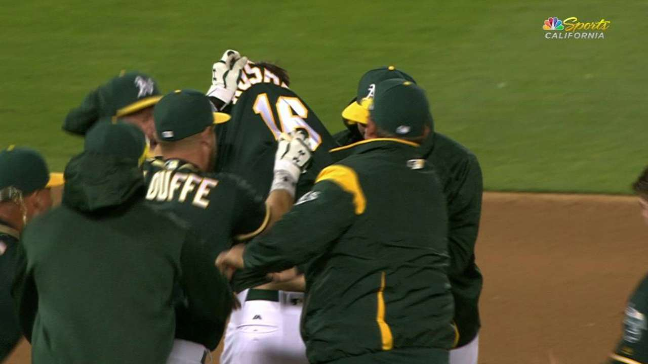 A's rally past Tigers on Rosales' walk-off single