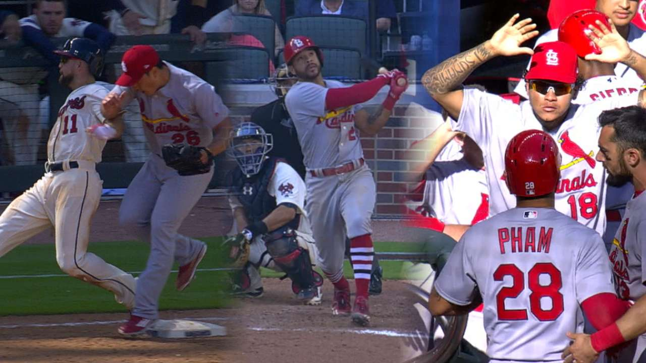 Pham-tastic! Cards win on 14th-inning HR