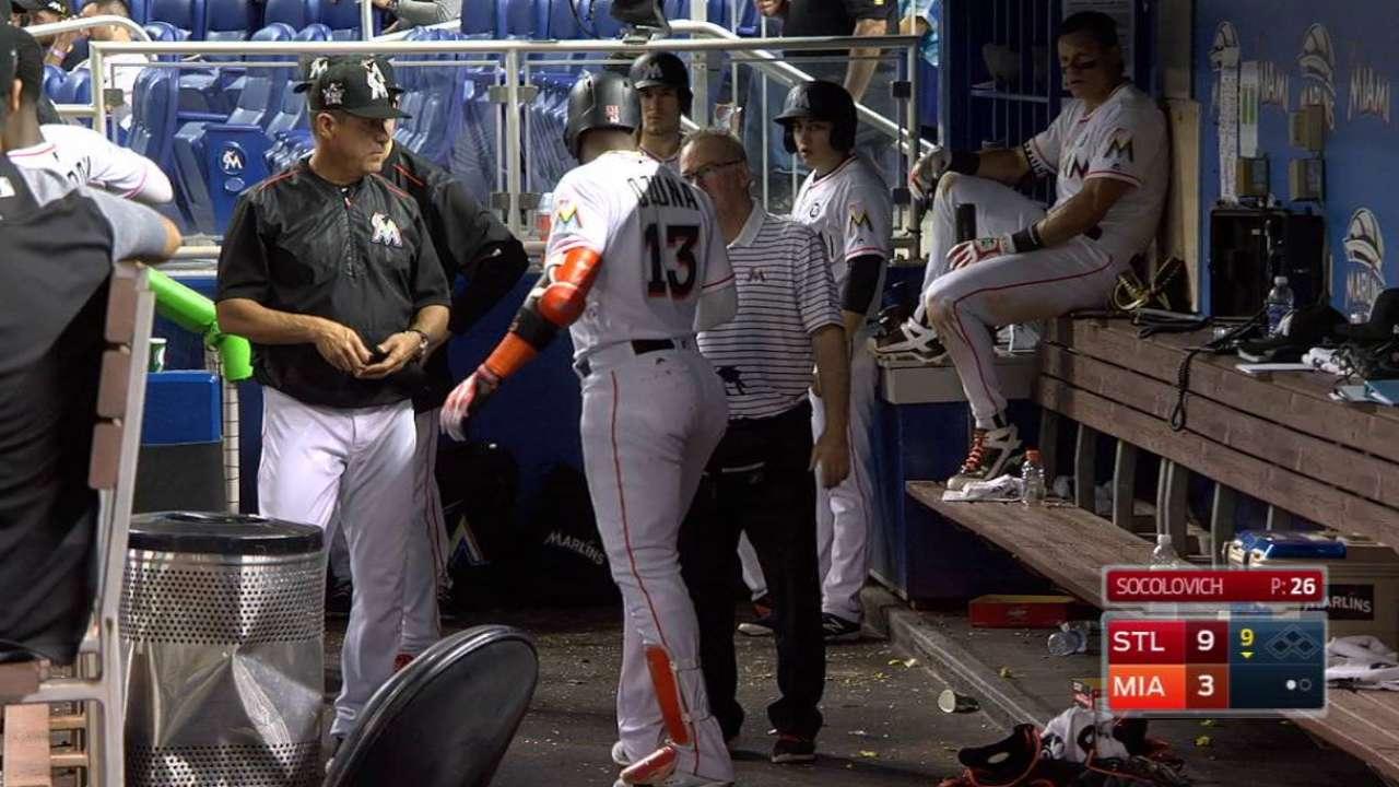 Ozuna shaken up on final at-bat