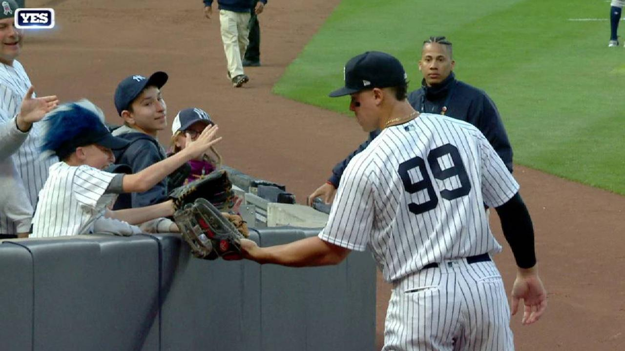 Judge gives ball to a young fan