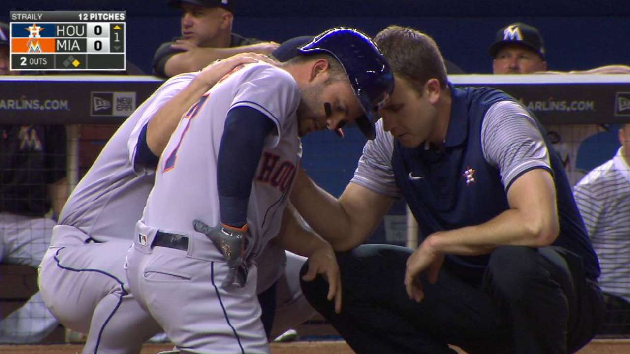 Altuve stays in after HBP