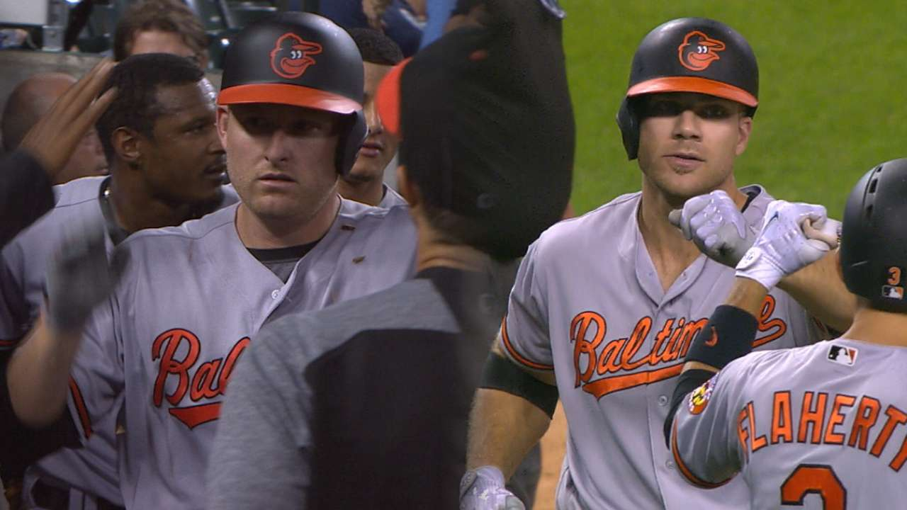 Davis' dual drives power O's in extras