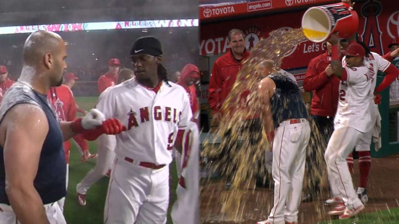 Pujols wraps big night with walk-off in 11th