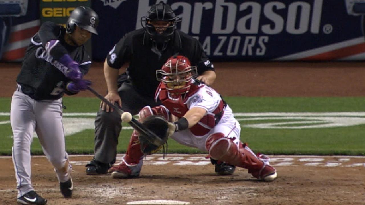 8-run inning propels Rockies past Reds