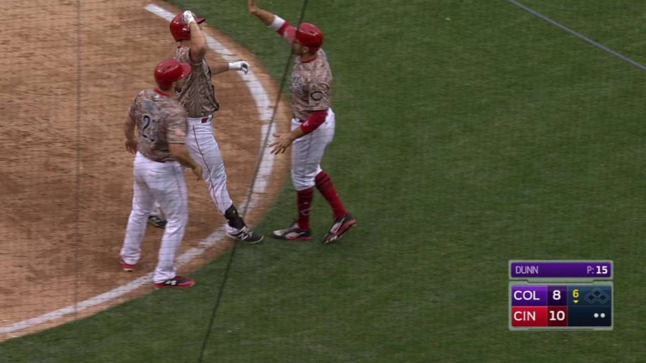 Three homers aid Reds in comeback win