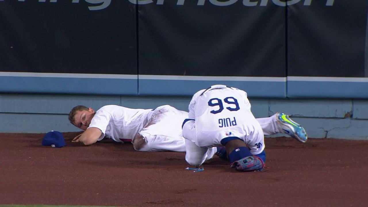 Pederson, Puig walk off after scary collision