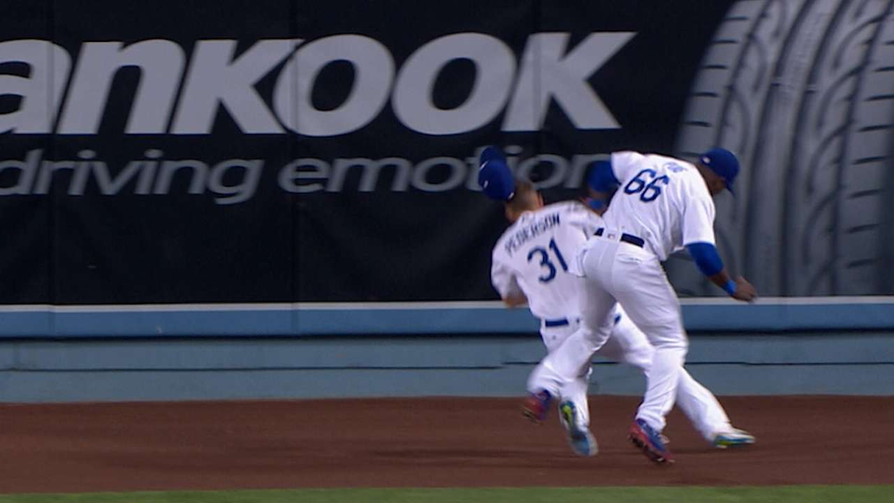 Puig, Pederson collide on catch