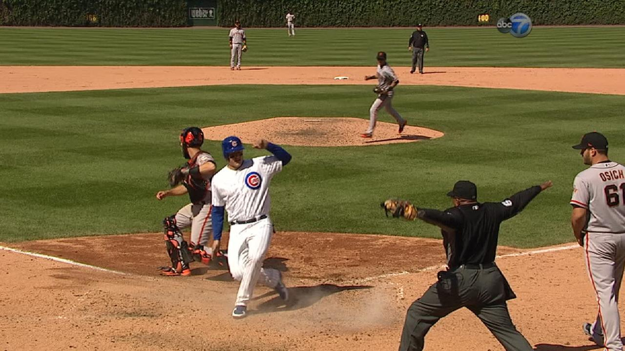 Cubs score two on wild pitch