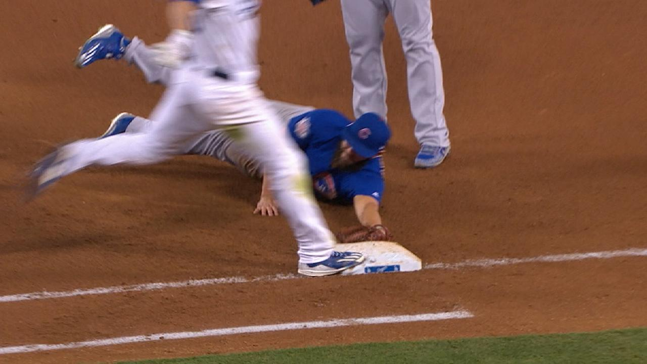 Arrieta's diving play at first