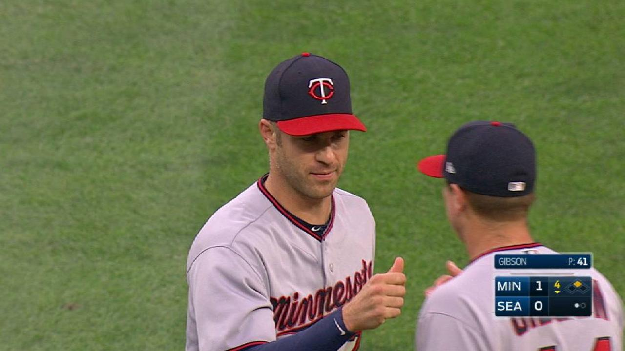 Mauer's diving stop at first