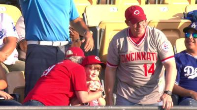Kid snags Scooter Gennett's record-breaking home run
