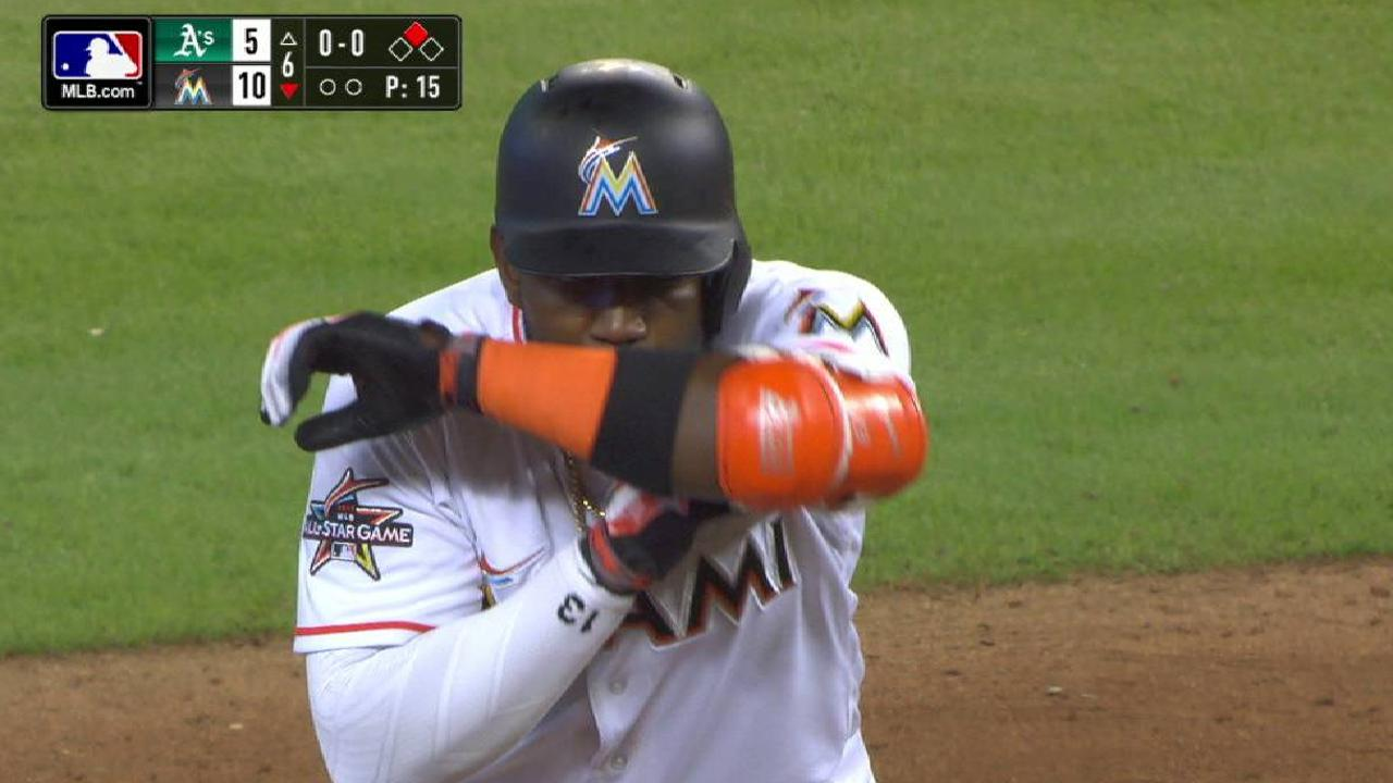 Ozuna drives in 3 to power Marlins past A's