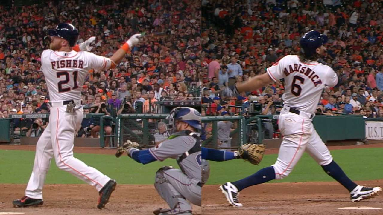 Astros roll behind fresh faces, 9-run sixth