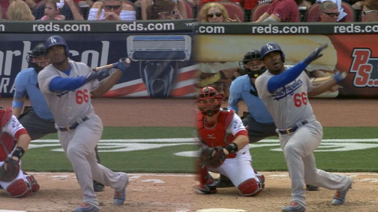Puig hits 2 of LA's 4 homers in win vs. Reds