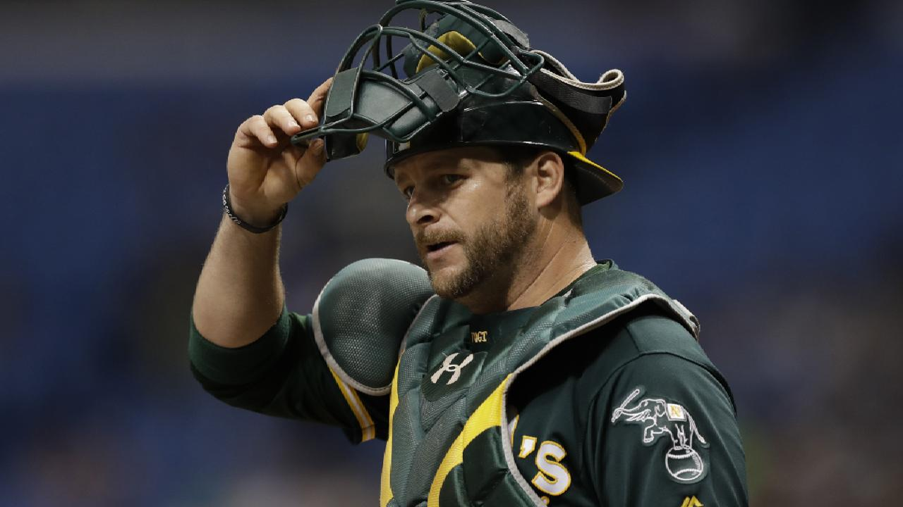 A's DFA two-time All-Star, team leader Vogt