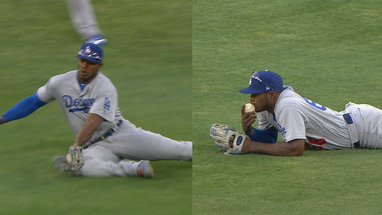 Puig kisses ball after catch