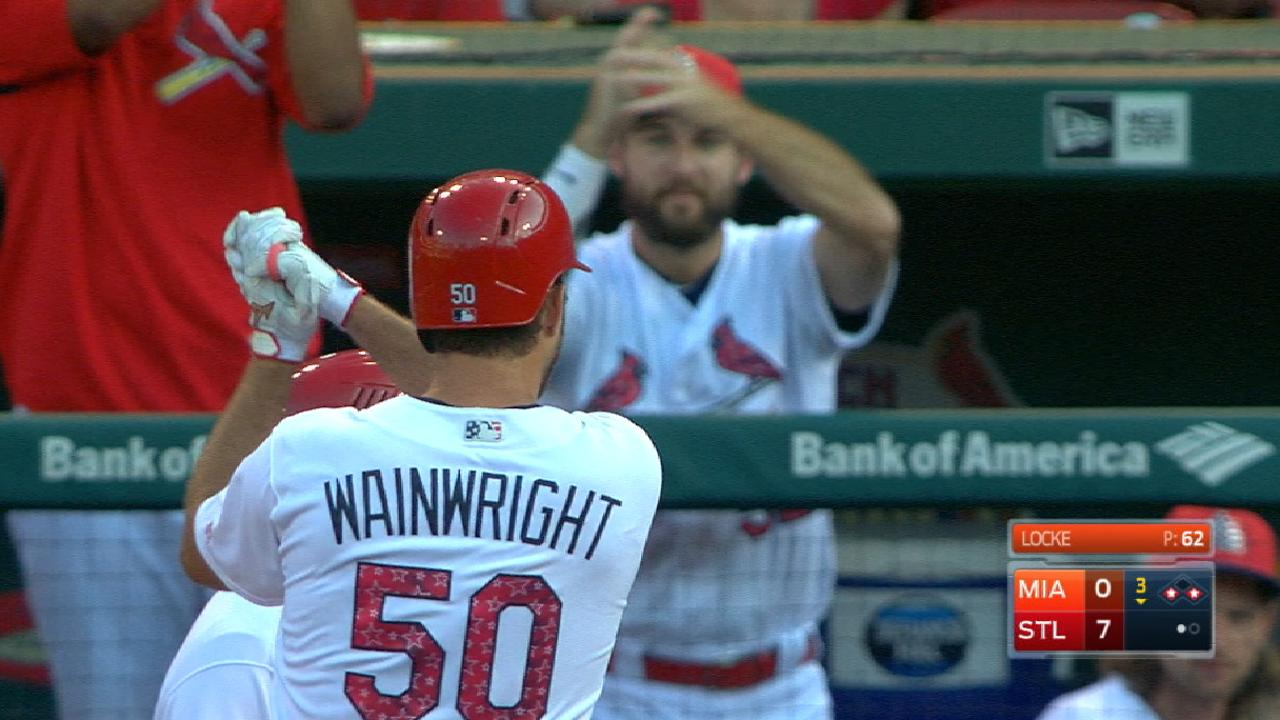 Cards surge early, finish strong to rout Marlins