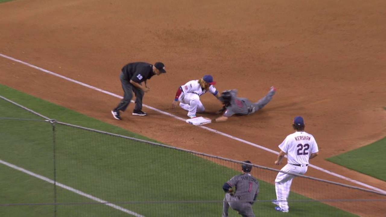 Owings' crafty slide at third