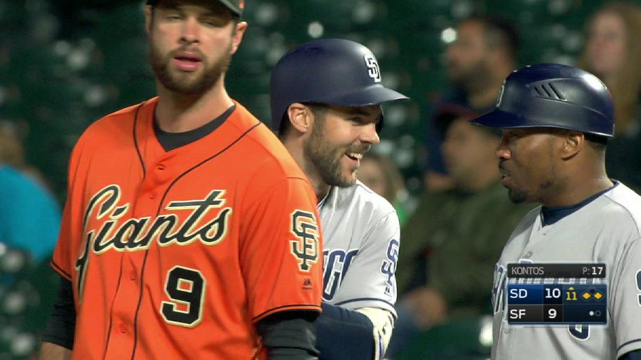 Padres rebound from Giants' rally, win in 11