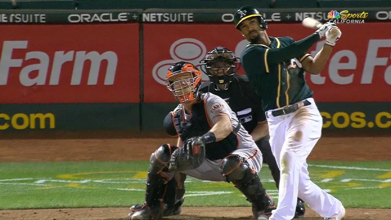 A's take Bay battle, KO Giants on grand slam