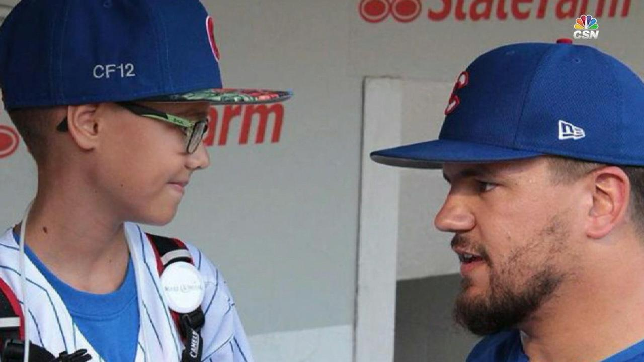 Schwarber hosts young fan's first Wrigley visit