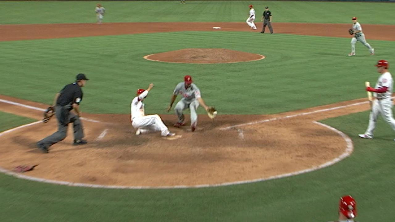 Simmons scores on a wild pitch