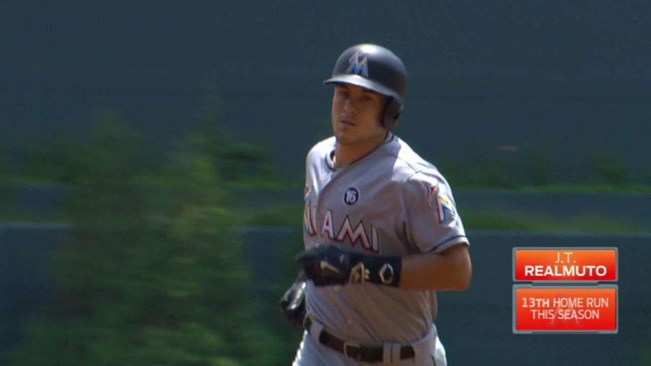 Realmuto homers, impresses in 1st start at 1B