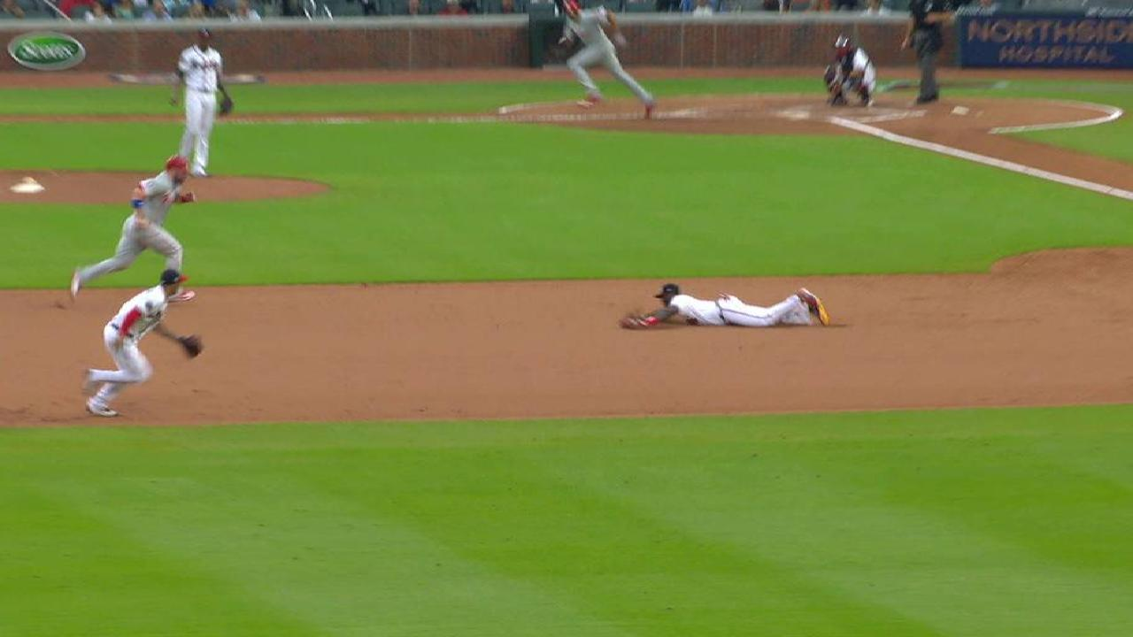 Phillips' diving play saves run