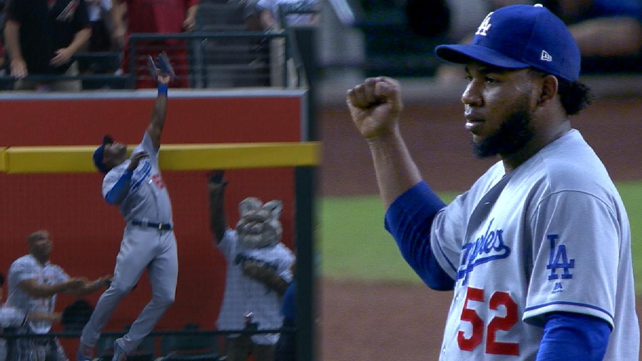 Puig robs D-backs homer with amazing catch