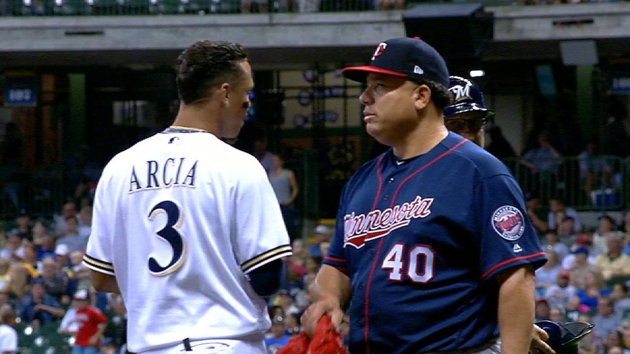 Colon and Arcia embrace