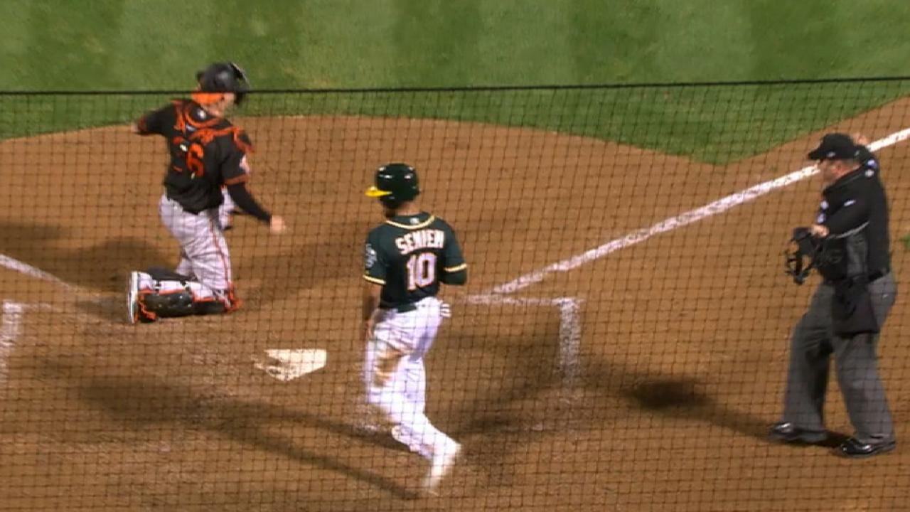 A's edge Orioles with two-run rally in eighth