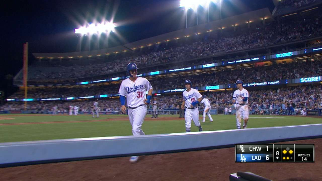 Dodgers rally to 50 games over .500