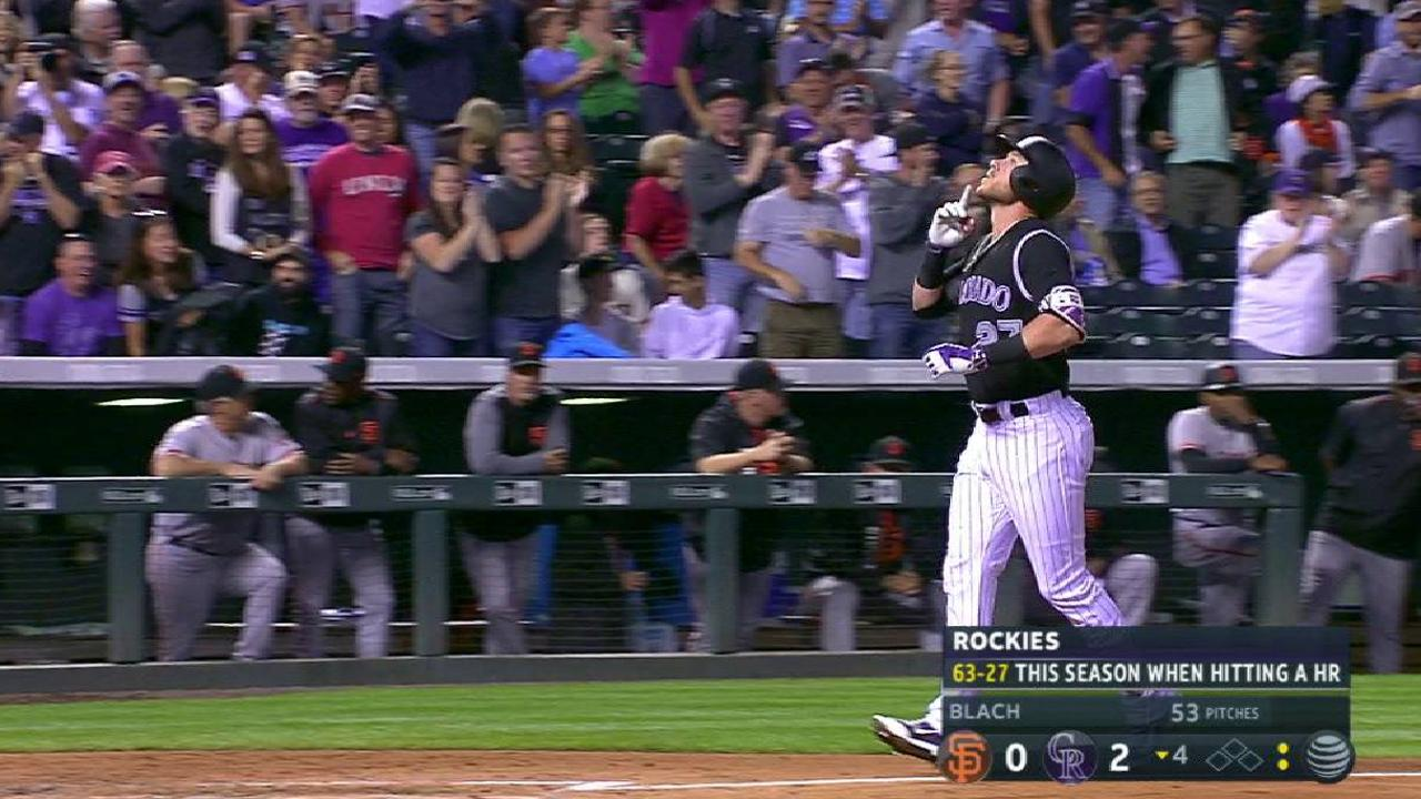 Story, Rockies top Giants, extend WC lead