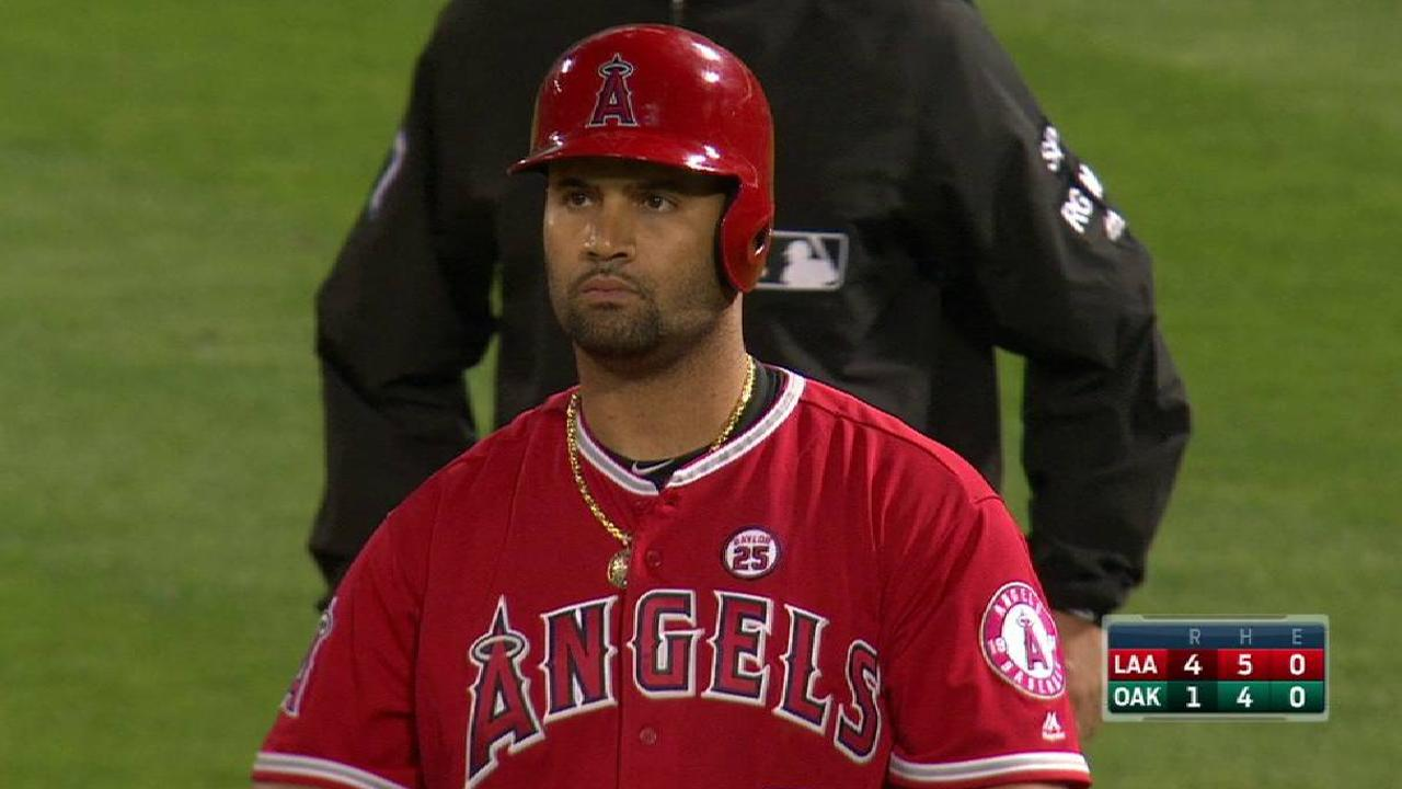 Pujols has bone bruise, cleared to play Friday