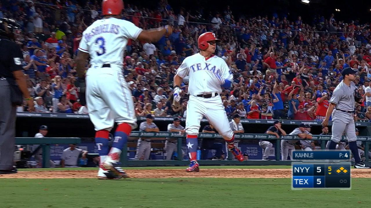 Rangers rally to upend Yanks, close WC gap