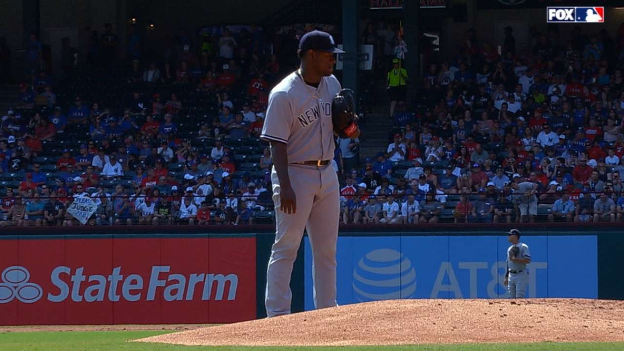 Yanks rally late, outlast Rangers in duel