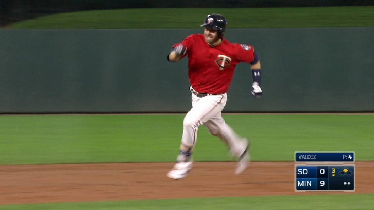 Dozier hustles for a triple