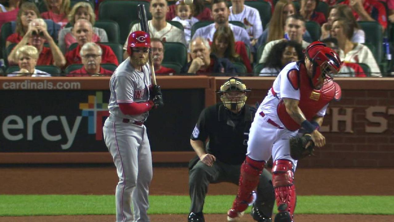 Cards slip in playoff chase with loss to Reds
