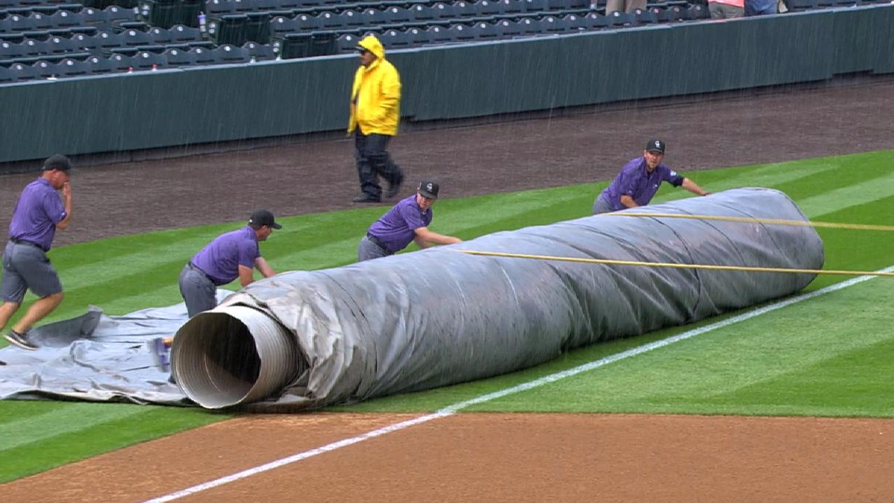 Rain delays play at Coors Field