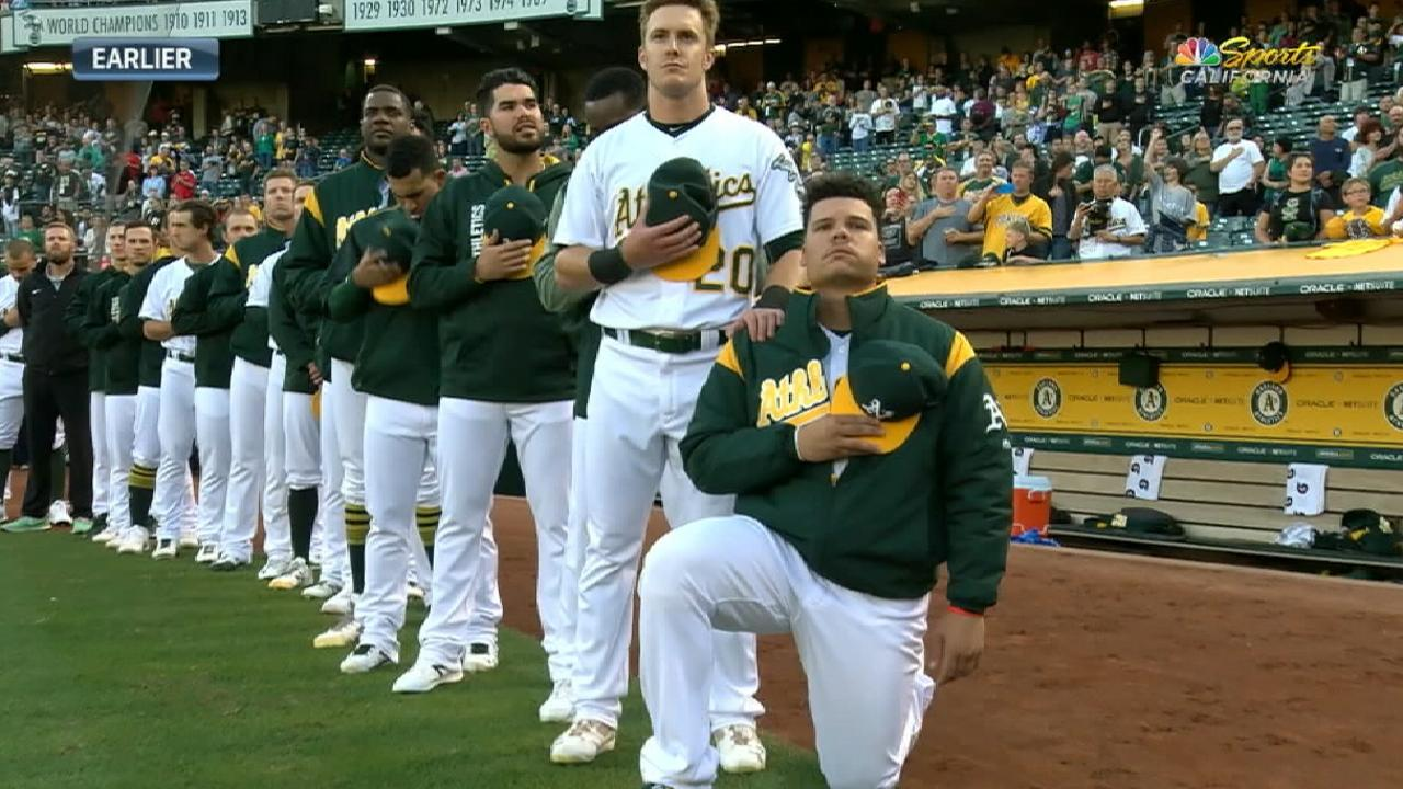 A's Maxwell kneels during anthem