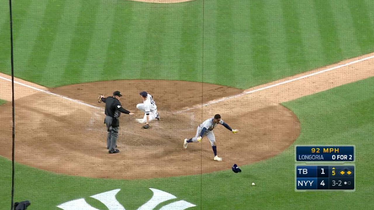 Smith scores on a wild pitch