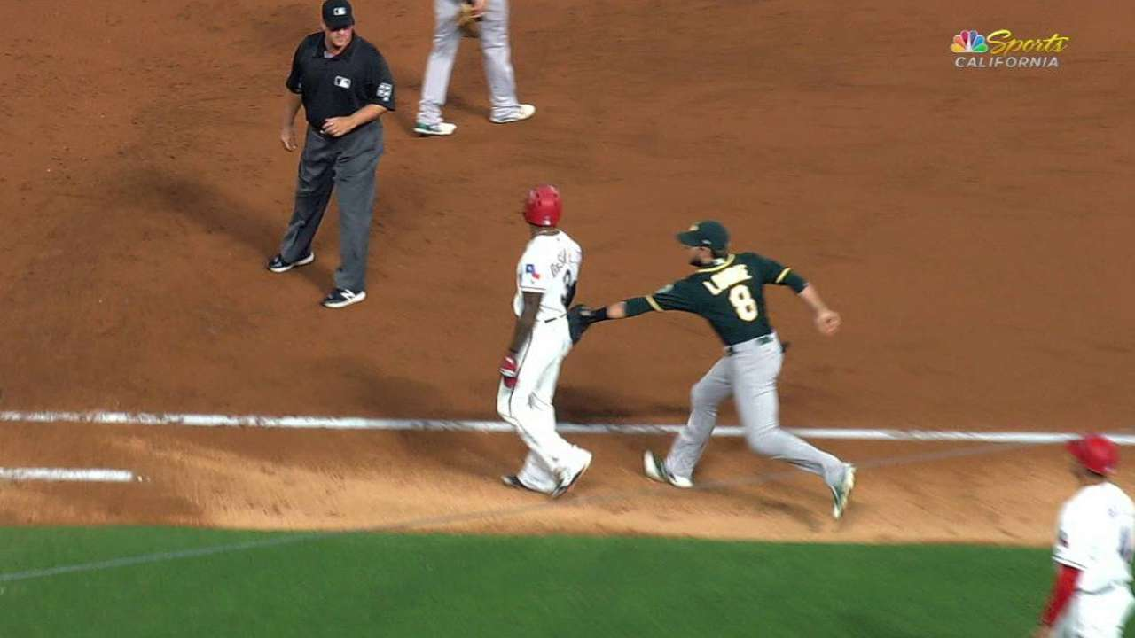 A's catch DeShields at first