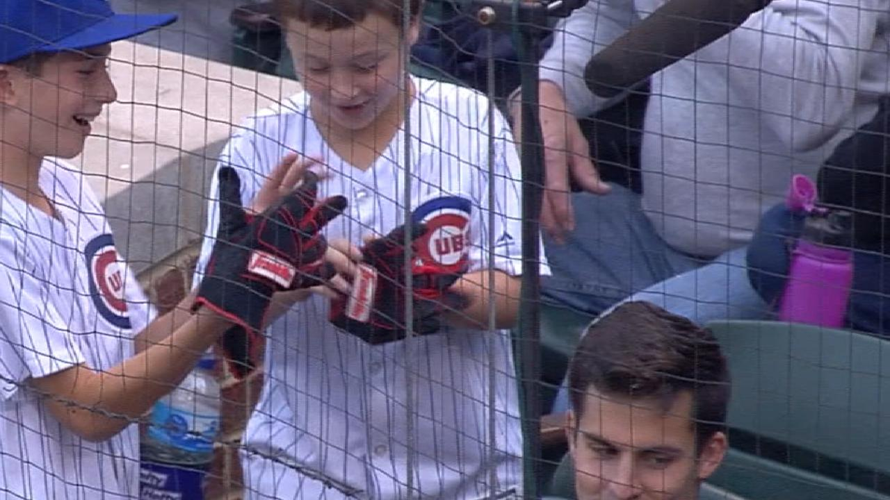 Votto gives his gloves to a fan