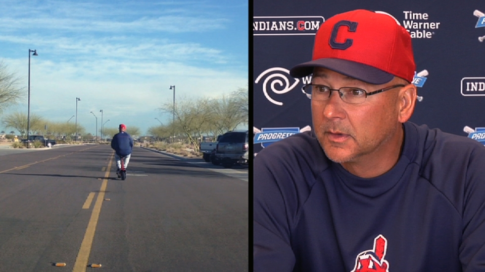 Terry Francona rides a scooter