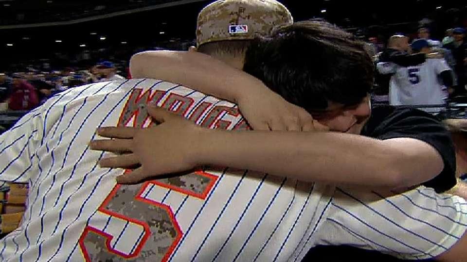 Wright hugs fan after win