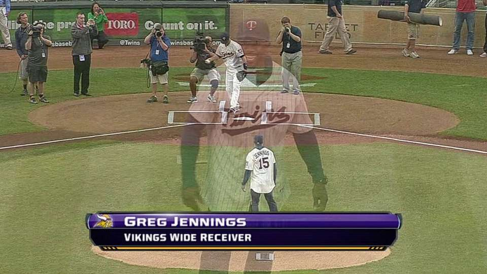 Greg Jennings throws first pitch