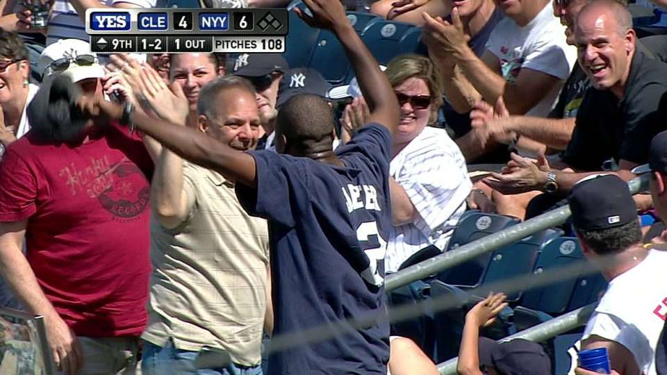 Fan makes over-the-railing catch